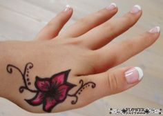Simple flower tattoo on girl's hand...