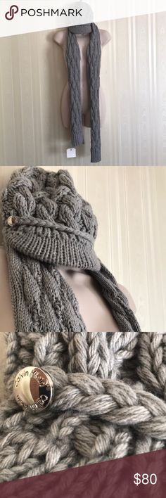 CALVIN KLEIN scarf hat and scarf set NWT Chunky cable knit, quite stylish and classic.  Pretty grey color, goes with everything.  Silver buttons on hat embossed with Calvin Klein.  Please note:  Tags will have barcodes blacked out prior to shipping to prevent fraudulent returns. Calvin Klein Accessories