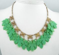 40s filigree and green celluloid leaf dangle charm necklace.