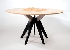 The Ocean's Edge table, a dining table created by American designer Tyson Atwell who finds inspiration from the movement of the tides of the San Francisco Bay.