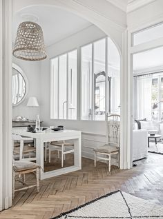 An apartment by the river Saone, in Lyon district 5 by Maison Hand. Photographs by Felix Forest. Herringbone Wood Floor, French Apartment, Dining Nook, Dining Chairs, Dining Table, White Rooms, Best Interior, Interiores Design, Vintage Decor