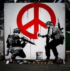 Banksy - Street Art/Graffiti: This piece of graffiti by Banksy could be seen as an oxymoron, this is because we can see 2 members of the army painting a bold red peace sign, whilst they are causing violence themselves, as they hold guns. As Banksy is a modern 21st century artist, these male figures would represent troops in a current war that is happening within the 21st century.
