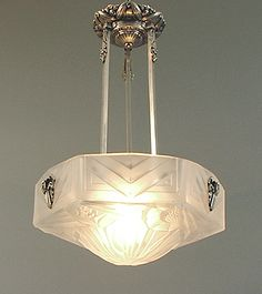 French Art Deco Wrought Iron and Nickel-plated brass and bronze Chandeliers with pressed glass shades and opalescent glass shades by Le Verre Francais, Schneider, Degue, Ranc, Muller, Verdun, Noverdy