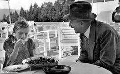 1937 Berghof terrace. Hitler smiles at a little girl eating cherries. (via putschgirl)