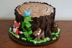 tree stump with woodland animals - bear, deer, fox &... More