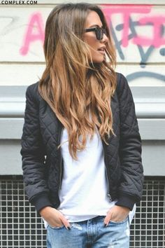 A classic bomber jacket. This is a cute jacket for women to wear. It looks good when paired with a spring look, such as with jeans, leggings, or over a dress.
