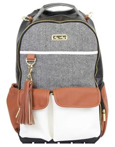 BOSS DIAPER BAG BACKPACK -- Parenting is an adventure sport so get the right gear. With a roomy interior and easy-access opening, this bag is perfect for the adventurous parent. Comfortable straps allows for hands-free exploration with little ones.  100% vegan leather tassel.  Tons of interior and exterior pockets, 19 total pockets (12 internal and 7 external, including two insulated bottle pockets) and a felt lined valuables pocket to protect contents. Coordinating easy wipe changing pad…