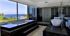 Bathroom with a sensational view in a luxury home for sale in Las Terrenas in the Dominican Republic - http://www.7thheavenproperties.com/real-estate/dominican-republic/5-bedroom-luxury-property-for-sale-las-terrenas/