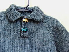 This sweater will fit babies and toddlers 12 to 18 months old. Hand knitted from denim blue and soft green wool yarn, this polo neck Baby Boys, Baby Boy Sweater, Boys Sweaters, Polo Neck, Wool Yarn, Pulls, Kids And Parenting, Baby Knitting, Blue Denim
