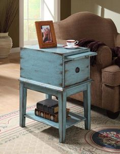 In a weathered and distressed sea blue finish, this simple cabinet has a bold personality full of rustic charm. One single deep drawer has a decorative pull and