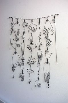 many hands wire art piece..from a house we rented in Bodega Bay,. Diane Komater wire artist