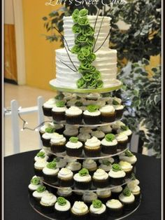 Wedding Cupcake Tower - I like the cake and cupcake combo, while still being classy.