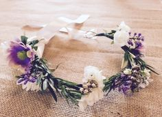 Purple and cream flower girl crown made from artificial flowers, so it can be something to treasure long after your special day!
