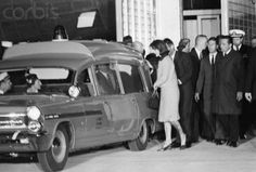 Jackie Kennedy stands behind the ambulance containing her husband's corpse, on November President Kennedy was assassinated only hours earlier during a motorcade in Dallas. Get premium, high resolution news photos at Getty Images Past Presidents, Greatest Presidents, American Presidents, Los Kennedy, John F Kennedy, Irish American, American History, Abraham Lincoln Family, Parkland Hospital