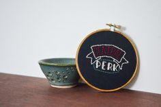 this is a custom made 4 embroidered hoop with a personal design created by randi. this canvas hoop says Central Perk which is the coffee shop from the popular tv series, Friends!   || a b o u t t h e p r o d u c t ||  - 4 wooden hoop - friends wall art - Central Perk - hand-stitched - canvas fabric - cream, green and maroon thread - medium walnut stain   || p e r f e c t f o r ||  - home decor - gift   || c u s t o m i z e ||  - custom orders always available!   || s h o w s o m e l o v e…