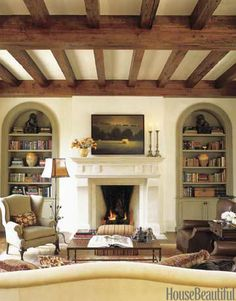 Old waxed ceiling beams, pale honey wall plaster, and a mix of French and Italian antiques create a family room that radiates warmth.