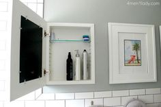 Hide bathroom cabnets behind wall art. They provide more than enough hidden storage.