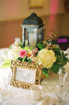 The tables and flowers had a romantic, Parisian garden look with antique wrought iron candle holders.
