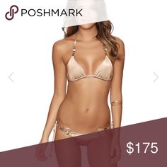 NWT Beach Bunny One Way Ticket Bronze Set M S Brand new Beach Bunny One Way Ticket Bronze color bikini set M too Small bottoms. The color is to die for the tie has intricate detail with crystal as well as the bottoms. I will post More pics later tonight. Beach Bunny Swim Bikinis