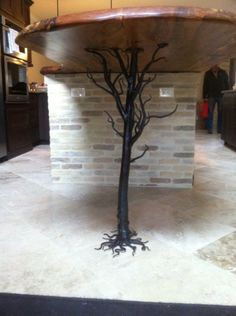 Hand-forged tree sculpture--decorative and functional for kitchen island support