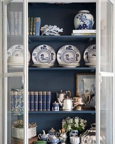 This carefully curated cabinet is stunning with the dark blue interior and lots of blue and white accessories! Glass Front Cabinets, Home Modern, Bookcase Styling, Blue And White China, Dark Blue, Interior Decorating, Interior Design, Decorating Ideas, French Country Decorating