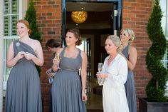 Charcoal Grey Ballgowns | twobirds Bridesmaid Dress | a real wedding featuring our multiway, wrap dresses | Photography: Lucy Davenport www.lucydavenport.co.uk | read more: http://www.stylemepretty.com/little-black-book-blog/2014/04/14/bride-dons-wedding-dress-made-of-flowers-2/ | the bride wore a dress made of real fresh flowers