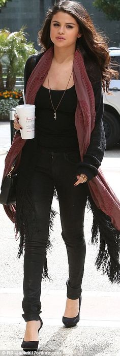 Taking it in her stride: Selena Gomez arriving at NBC/Universal studios in LA on Friday 1126 333 3