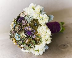 Brooch bouquets. Very unique and a  way to add something borrowed. This would be a great start to a family wedding tradition.