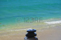 Beach with zen stones in harmony nature balance vivid colors Stock Photo