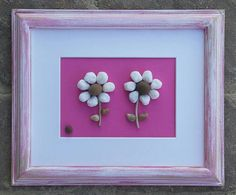 FREE SHIPPING  This artwork will be made to order.  Two absolutely precious white pebble flowers set on a bright pink hand painted background in an 8.5x11 open wood frame that is painted in acrylics and distressed. Ready to hang or stand.  Thank you so much for looking. Please message with any questions....P.S. I love special requests - dont forget to check out my shop