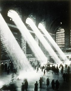 1937: Grand Central Station (NYC Dept. of Records, Municipal Archives)  It has been one of my photographic goals to capture light rays, as they flowed in thru my kitchen windows or down thru a forest canopy. This photo, besides taking my breath away with its statement of architectural majesty, was instructional; the over-exposed windows, the motion blur of the commuters, both indicate that I need to go with much longer exposures. In-door smoking in those days probably helped as well.