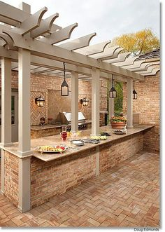 the pavers and brick work well together and the pergola color is on point