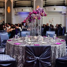 Textured silver linens and gun-metal chair covers complemented the room's existing decor and kept focus on the lush purple flowers.