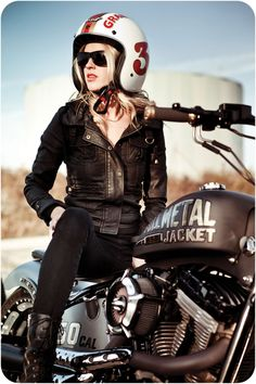 A woman on a motorbike is is definitly a beautiful sight.. no matter when, where........