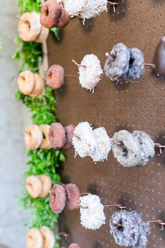 A wall of donuts! Now this is a fun idea, who said you have to have cake anyway? | 100 Layer Cake