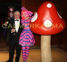 Alice in Wonderland themed Cheshire Cat poses elegantly for pics with guests by her magical mushroom -  Tel: 020 3602 9540  UK Entertainment Agency  http://www.calmerkarma.org.uk/Alice-in-Wonderland.htm Manchester, Bristol, Leeds, London, Birmingham