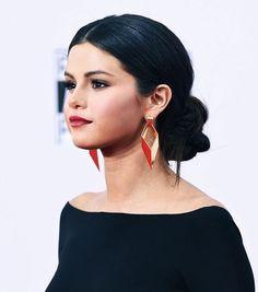 Selena Gomez's big, braided bun and sleek center part are so stunning