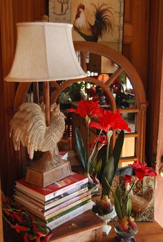 vignette with rooster lamp, books, mirror