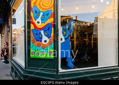 Blue Dog paintings and installations by George Rodrigue in a gallery on Royal Street, New Orleans Stock Photo