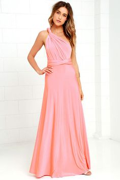 """Any which way you wrap it, the Always Stunning Convertible Coral Pink Maxi Dress is one amazing dress! Two, 83"""" long lengths of fabric sprout from an elastic waistband and wrap into dozens of possible bodice styles including halter, one-shoulder, cross-front, strapless, and more. Stretchy coral pink fabric has a satiny sheen, and a full-length maxi skirt pairs perfectly with any choice you make up top. Want Styling Tips? <a href='http://bit.ly/HowToWearIt' target='_blank'>See How To Wear…"""