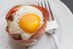 Shirred Eggs with Sausage and Spinach « The Domestic Man. Baked egg cup breakfast for a crowd.