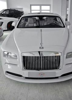 Triple white Rolls Royce Phantom
