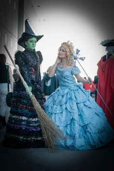 "A lovely Wicked cosplay with Elphaba's Act Two gown and Glinda's ""No One Mourns the Wicked"" gown."