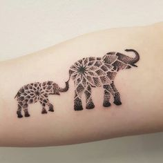 Cute Elephant Tattoos - Elephant Flower Tattoo - Mother and Baby Elephant - The Best Elephant Tattoo Designs - Cute Elephant Tattoo Designs and Ideas - Sexy Thigh Tattoo, Small Elephant Tattoo, Elephant Outline, Elephant Tattoo Meanings Elephant Family Tattoo, Mandala Elephant Tattoo, Elephant Thigh Tattoo, Elephant Tattoo Meaning, Colorful Elephant Tattoo, Cute Elephant Tattoo, Elephant Outline, Elephant Tattoo Design, Baby Elephant