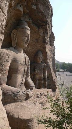 ancient Buddha statues at the Yungang Grottoes, China Loved and Pinned by www.downdogboutique.com to our Yoga community boards