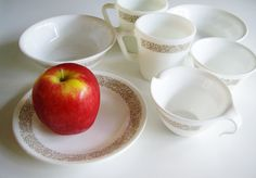 This set of vintage Corelle dishes is perfect for breakfast for 2! Corelles Woodlands pattern is a great line drawing of brown flowers and leaves. The set comes with 2 Pyrex mugs in Woodlands, 2 side plates, 2 bowls and a cream and sugar.  Note: Please see this link for more Corelle in my shop. https://www.etsy.com/ca/shop/Vintagerous?ref=hdr_shop_menu&search_query=corelle  DIMENSIONS: Mug: 3 1/2 (8.5 cm) wide x 3 1/2 (8.5 cm) tall Bowl: 6 1&#x...