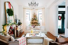 Christmas as in the movies: a super-cozy home in Chicago #white #Living #Room #festive #Holiday #decor #design #Interior #mirror #fireplace