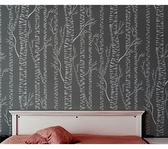 Tree stenciled accent wall! would do this with the tree outline being the same color as the rest of my room and the background being white