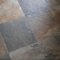 tile that's ceramic but looks slate . entryway and kitchen maybe