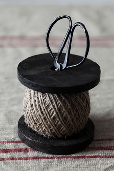 spool of cord on a wooden thread spool